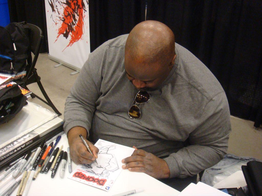 ken lashley sketching at niagara comic con