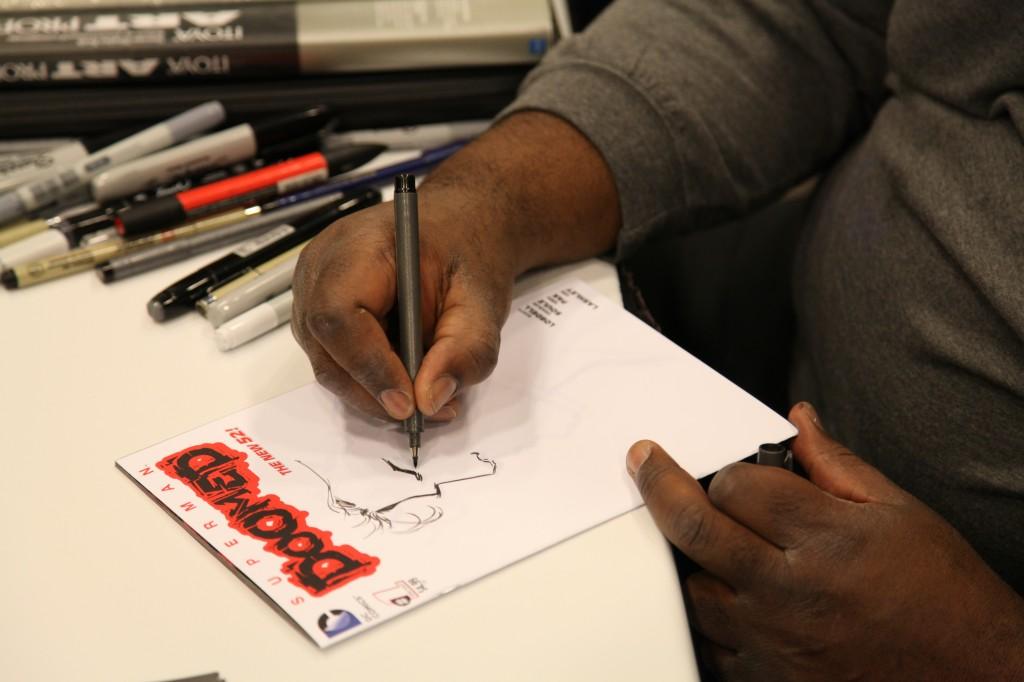 ken lashley super close up doing sketch cover