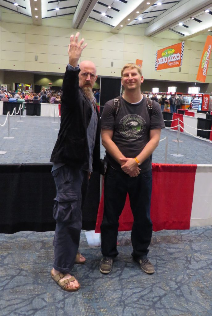 brian azzarello and fan at fan expo